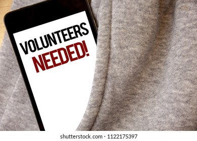Handwriting text writing Volunteers Needed Motivational Call. Concept meaning Social Community Charity Volunteerism Hoar frost color side pocket cell phone be visible black and red letters.