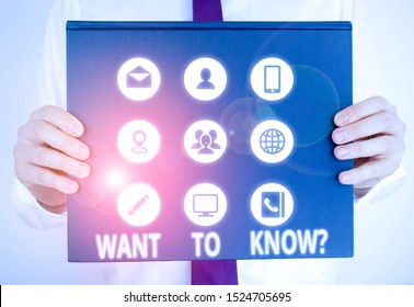 Handwriting text writing Want To Know Question. Concept meaning Request for information Asking Wonder Need Knowledge Male human holding thick textured cardboard of business promotion concept.