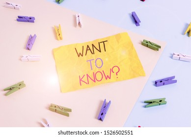 Handwriting text writing Want To Know Question. Concept meaning Request for information Asking Wonder Need Knowledge Colored clothespin paper empty reminder yellow blue floor background office.