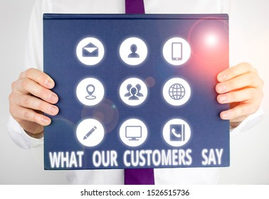Handwriting text writing What Our Customers Say. Concept meaning to know Users Feedback the Consumers Reactions Male human holding thick textured cardboard of business promotion concept.