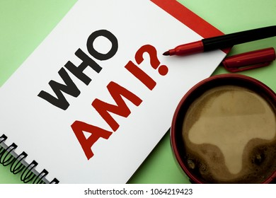 Handwriting text writing Who Am I Question. Concept meaning Question Asked Identity Thinking Doubt Psycology Mystery written on Notebook Book on the plain background Coffee Cup next to it.