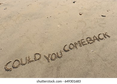 """Handwriting  words """"COULD YOU COME BACK"""" on sand of beach."""