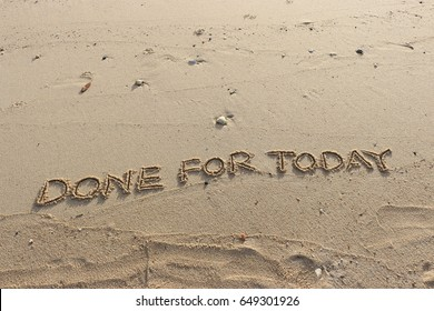"""Handwriting  words """"DONE FOR TODAY"""" on sand of beach."""