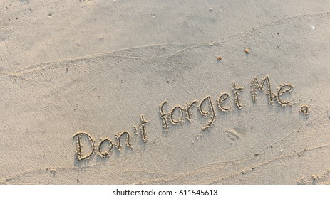 """Handwriting words """"Don't forget Me."""" on sand of beach"""
