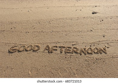 """Handwriting  words """"GOOD AFTERNOON"""" on sand of beach."""