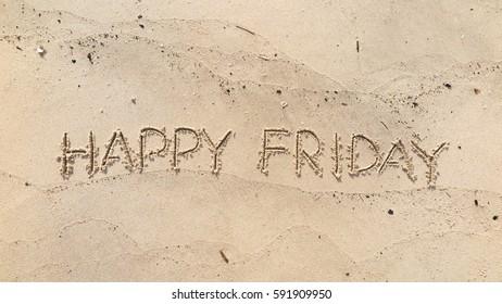 "Handwriting words ""HAPPY FRIDAY"" on sand of beach"