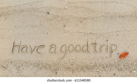 """Handwriting words """"Have a good trip"""" on sand of beach"""