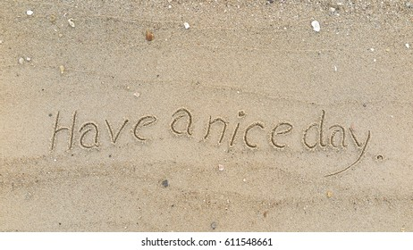 """Handwriting words """"Have a nice day"""" on sand of beach"""
