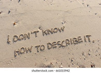 """Handwriting  words """"I DON'T KNOW HOW TO DESCRIBE IT. """" on sand of beach."""
