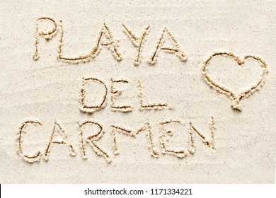 "Handwriting words ""Playa del Carmen"" on sand of beach"
