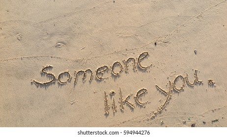 "Handwriting words ""Someone like you."" on sand of beach"