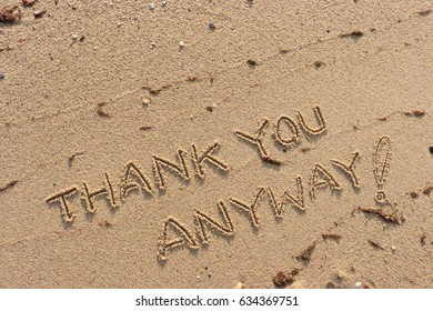 """Handwriting  words """"THANK YOU ANYWAY!"""" on sand of beach."""