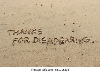 """Handwriting  words """"THANKS FOR DISAPEARING."""" on sand of beach."""