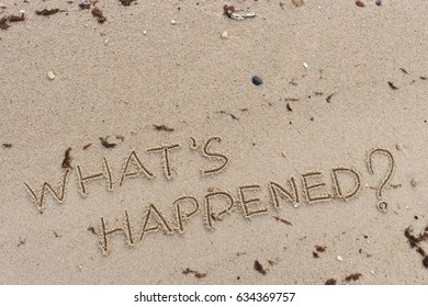"Handwriting  words ""WHAT'S HAPPENED?"" on sand of beach."
