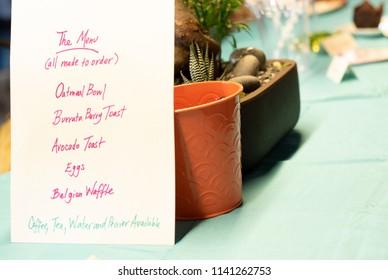 Handwritten brunch menu on a table