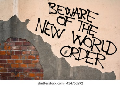 Handwritten graffiti Beware Of The New World Order sprayed on the wall, anarchist aesthetics. Caution on conspiracy theory about secret totalitarian world government