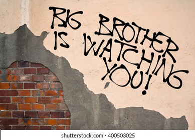 Handwritten graffiti Big Brother Is Watching You sprayed on the wall, anarchist aesthetics