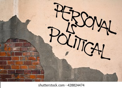 Handwritten graffiti Personal Is Political sprayed on wall, anarchist aesthetics - connections between private experience and politics