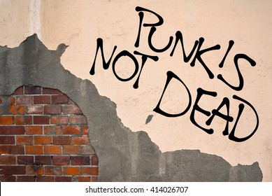 Handwritten Graffiti Punk Is Not Dead Sprayed On The Wall Anarchist Aesthetics Appeal To