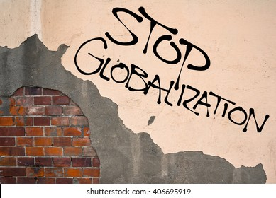 Handwritten graffiti Stop Globalization sprayed on the wall, anarchist aesthetics
