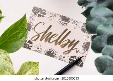 """A handwritten greeting card with the name """"Shelby"""" on it."""