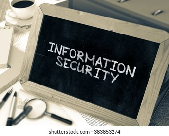 Handwritten Information Security on a Chalkboard. Composition with Chalkboard and Ring Binders, Office Supplies, Reports on Blurred Background. Toned Image. 3D Render.