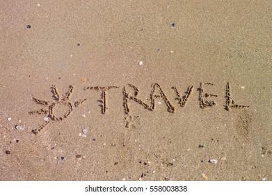 Handwritten inscription on sea sand, close up view