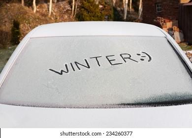 Handwritten inscription Winter on the Ice car rear glass window
