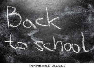 Handwritten message on a school chalkboard writing concept inscription, communication message Back to school