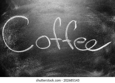 Handwritten message on a school chalkboard writing concept inscription, communication message title Coffee