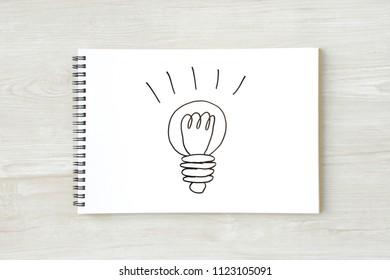 Handwritten midget lamp on sketchbook