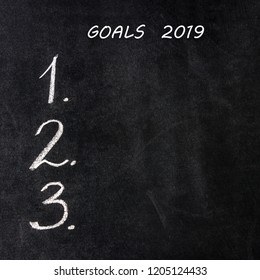 Handwritten numbers. 2019 New Year's. Concept- goals list, motivational, decision, choice, resolution. Copy space.