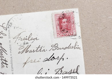 handwritten old postcard with stamp