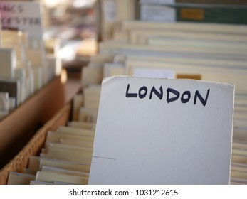 Handwritten sign with London written in capitals on a box of paintings for sale on the south bank of the Thames