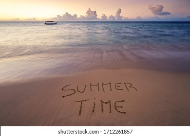 Handwritten Summer Time on sandy beach at sunset,relax and summer concept,Dominican republic beach.