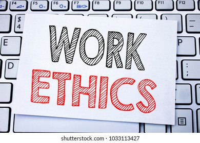 Handwritten text caption showing Work Ethics. Business concept writing for Moral Benefit Principles written on sticky note paper on the white keyboard background.
