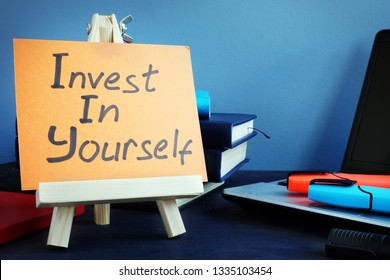 Handwritten text Invest in yourself. Self motivation concept.