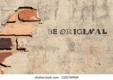 A handwritten text message on ruined cracked brick wall background : BE ORIGINAL! , concept of be yourself ,dare to be different, with fearless attitude