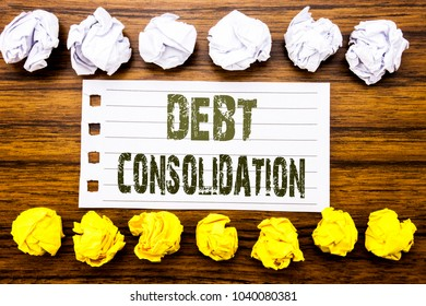 Handwritten text showing Debt Consolidation. Business concept for Money Loan Credit Written on sticky note, wooden with sticky, many folded paper white and yellow for difference or collaboration