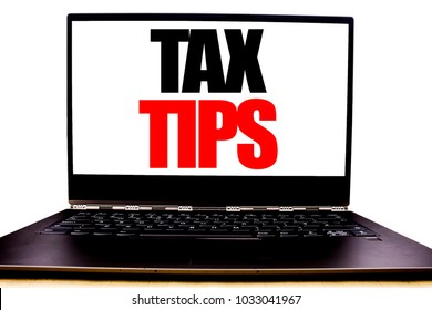 Handwritten text showing Tax Tips. Business concept writing for Tip Forn Taxes Written on monitor front screen, white background with space view.