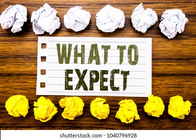 Handwritten text showing What To Expect. Business concept for Achieve Expectation Written on sticky, wooden with sticky, many folded paper white and yellow for difference or collaboration