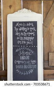 Handwritten Unplugged Wedding No Photos Please Hipster Wedding Photographer Media Announcement Request on Quaint Chalkboard Sign Indoors