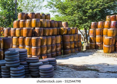Handycraft ceramic vases are drying in the yard of an old potterâ??s kiln in trade village, Binh Duong, Viet Nam.