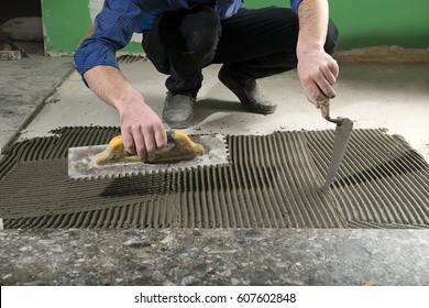 Handyman Applying Ceramic Glue