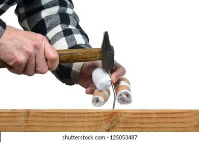 a handyman awkward trying to hammer a nail