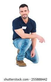 Handyman crouching on white background