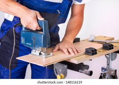 Handyman with jigsaw