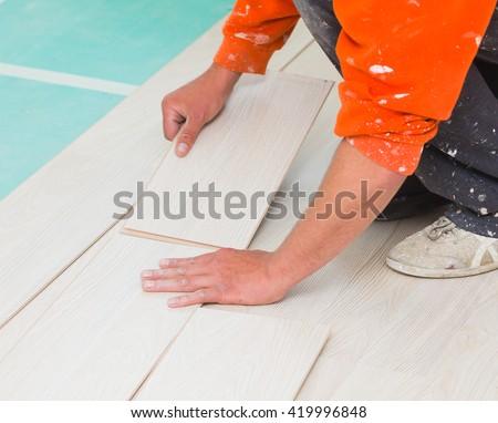 Handyman Laying Down Laminate Flooring Boards Stock Photo Edit Now