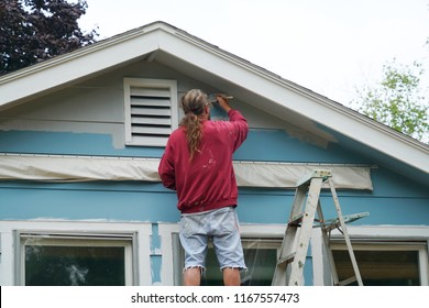 handyman painting house external wall for home renovation