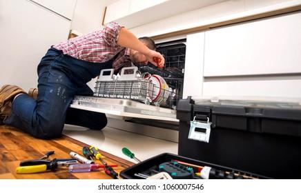 Handyman repair dishwasher in  the kitchen